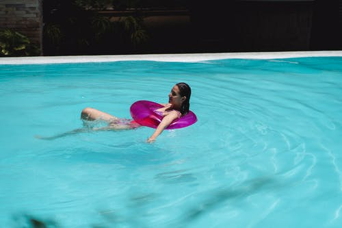 Young woman in pool with swimming circle