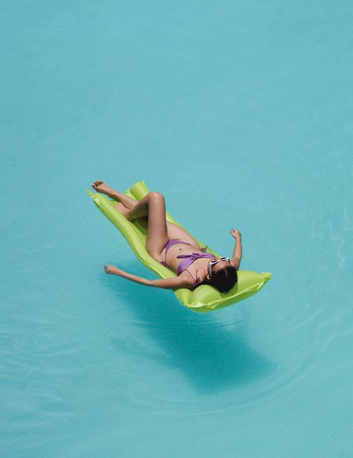 Relaxed woman lying on air mattress