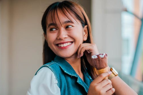 Delighted Asian woman with ice cream