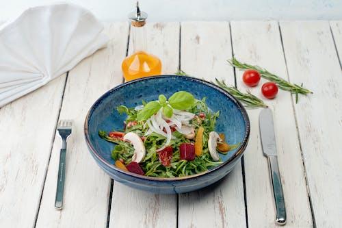 Blue Ceramic Bowl With Vegetable Salad