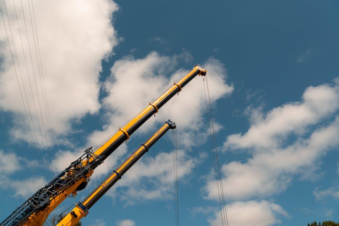 Yellow Crane Under Blue Sky
