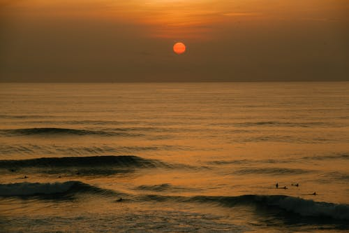 Amazing sunset over waving sea in evening