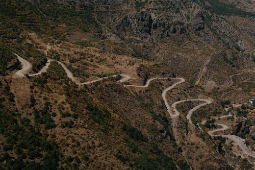 Asphalt winding roadway on mountain slope