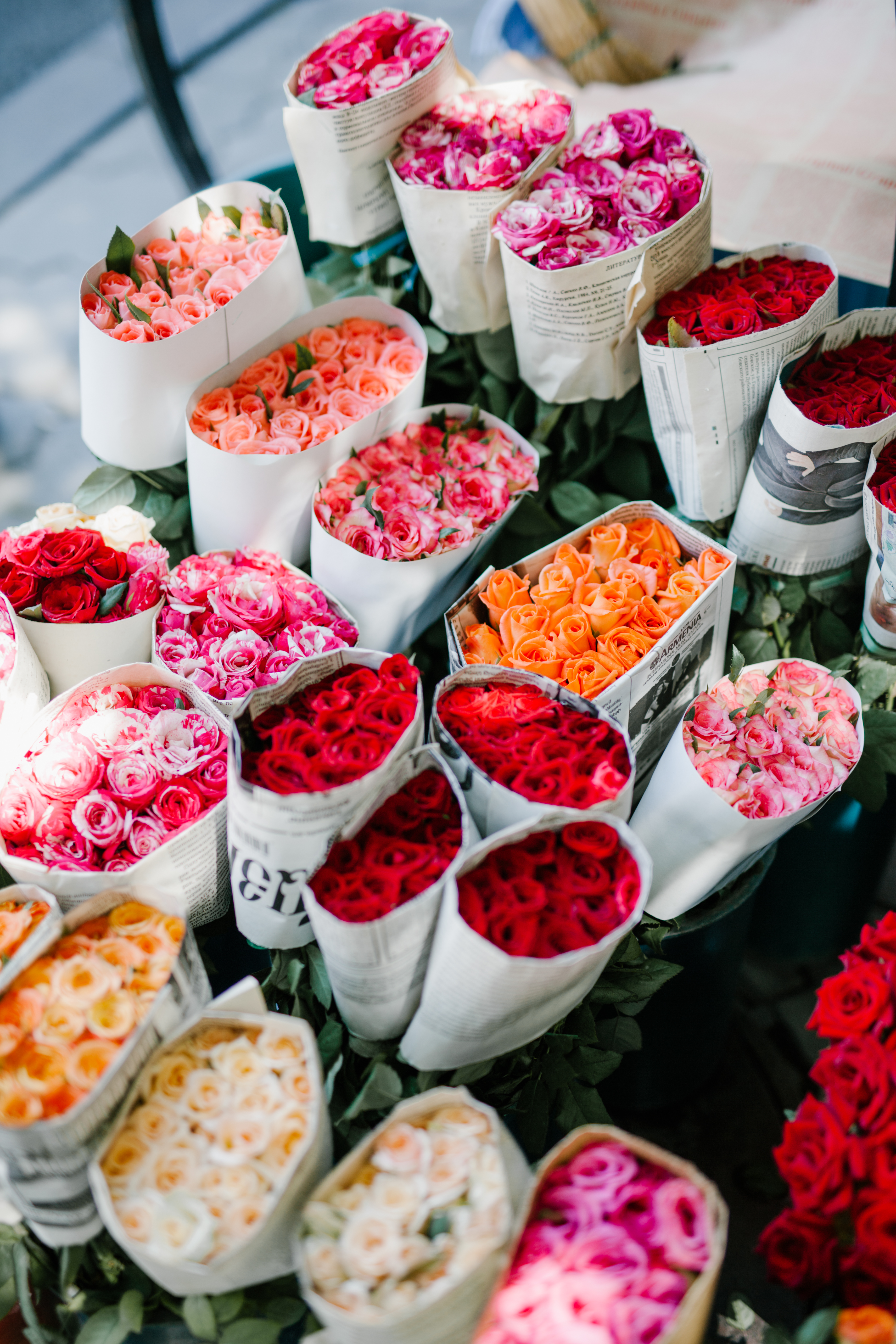assorted bunches of roses in flower market