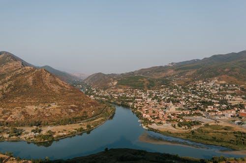 Blue river flowing through mountainous terrain