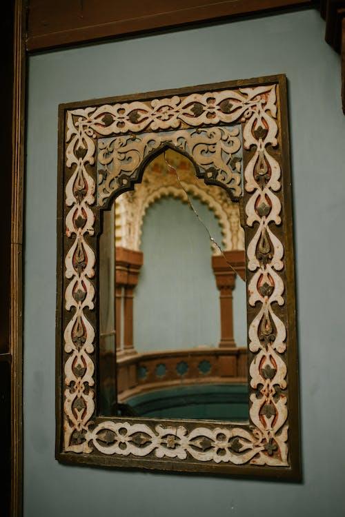 Ornamental mirror on wall of oriental building