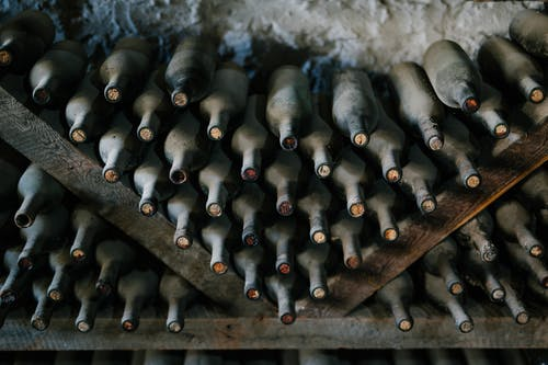 Bottles of wine with corks in cellar