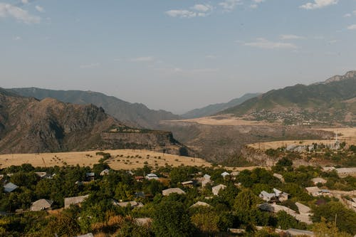 Small settlement located in green valley in mountainous terrain