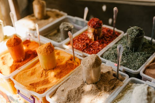 Assorted spices at counter in street market