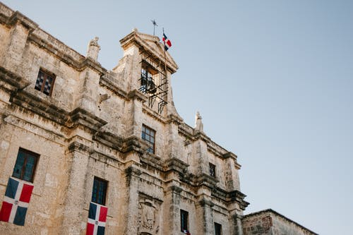 Facade of old building with flag of Dominican Republic