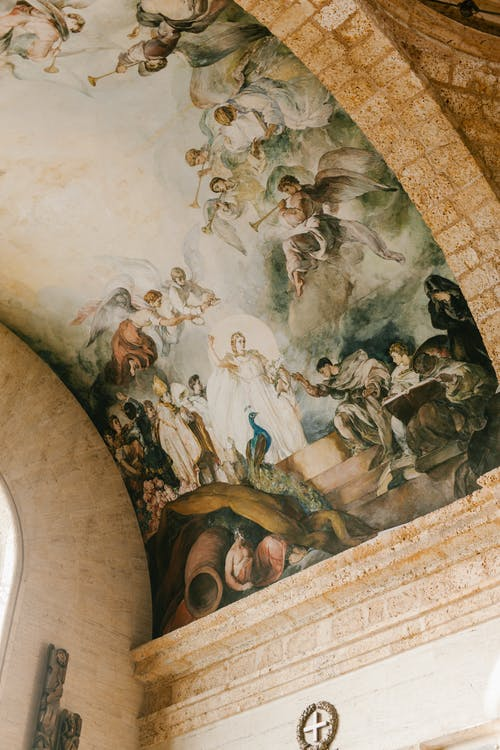 From below of aged round ceiling of stone building decorated with frescoes in National Pantheon of Dominican Republic