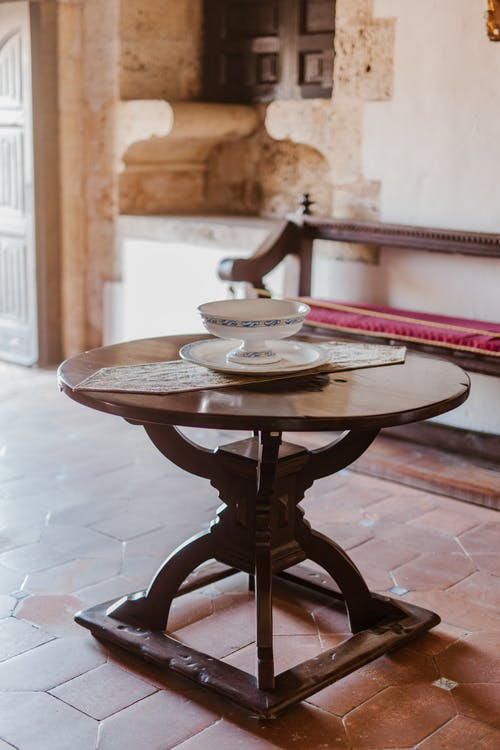 Wooden table with porcelain dishware in oriental room