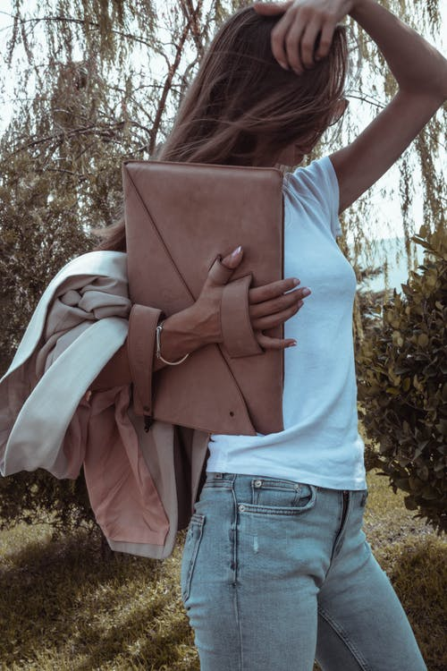 Woman in casual wear with stylish handbag