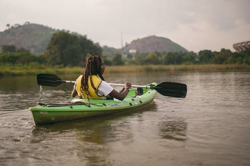 A Woman Riding a Kayak on a Lake