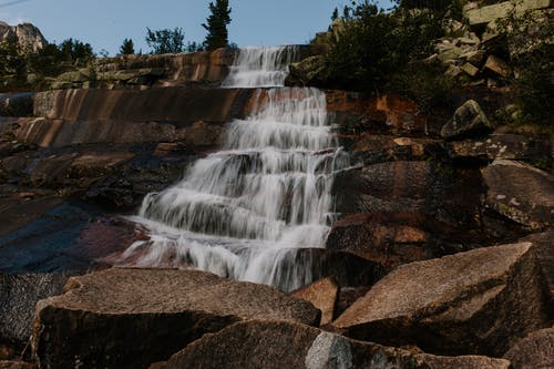 Clean waterfall flowing on rocky formation