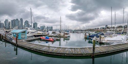 Boats on Dock under Gray Sky