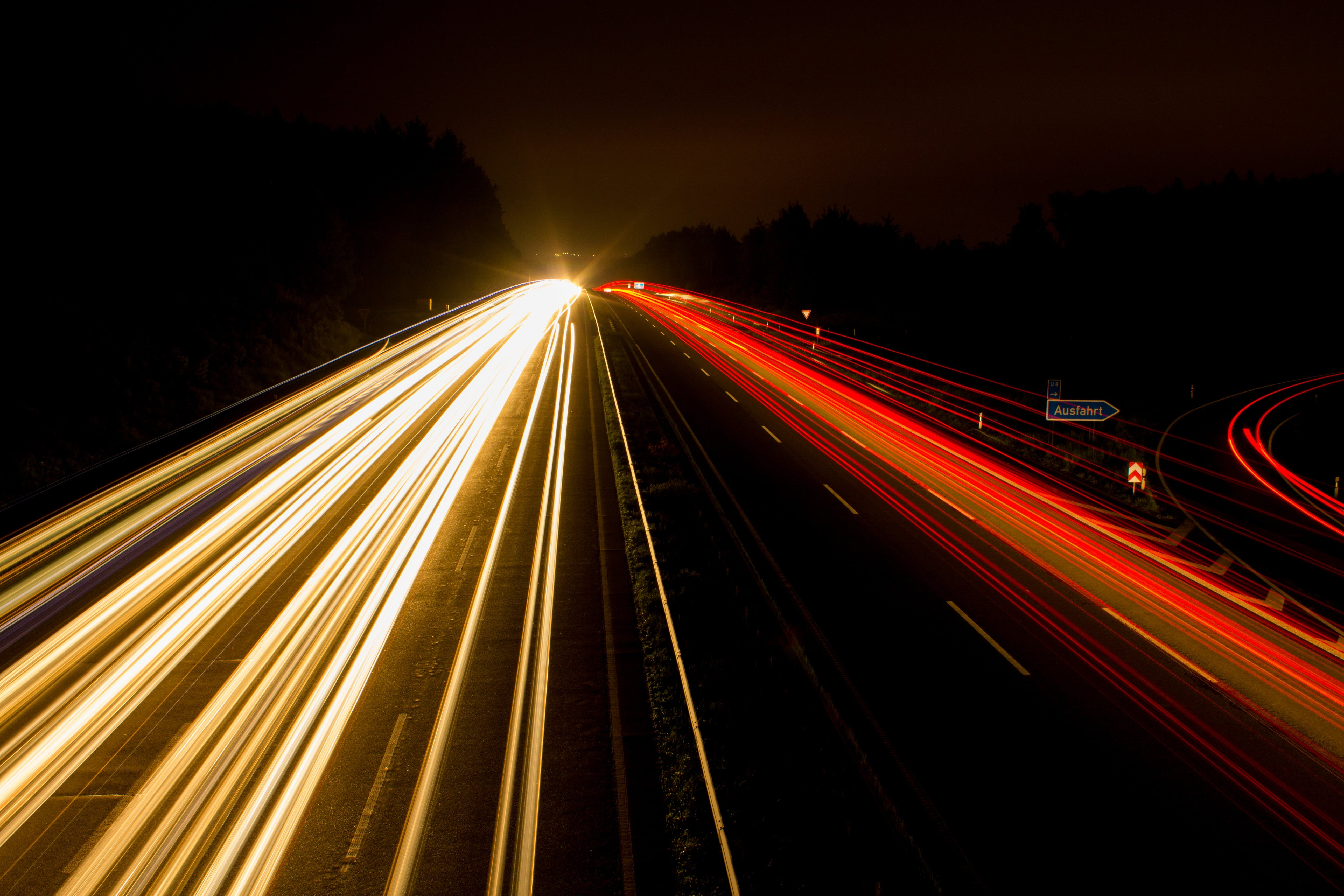 Speeding Car on High Way during Night Time