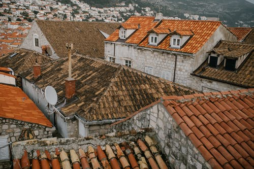 Old tiled roofs of dwell buildings