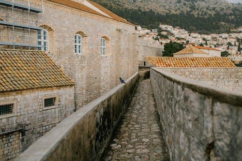 Masonry walkway on height in city