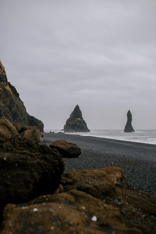 Black Rock Formations on Seashore
