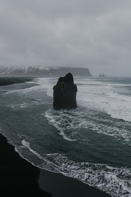 Black Rock Formation on Beach Shore