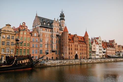 Old European city district on river coast
