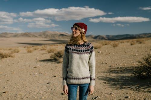 Woman in sunglasses in desert