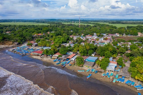 Aerial View of Houses on Beach