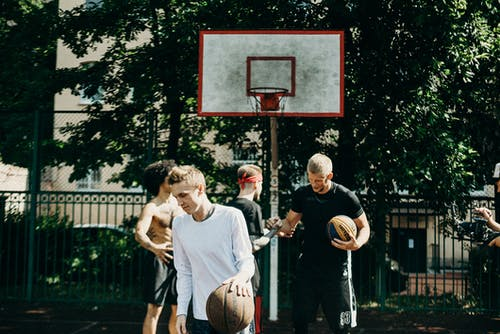 People Playing Basketball on the Street