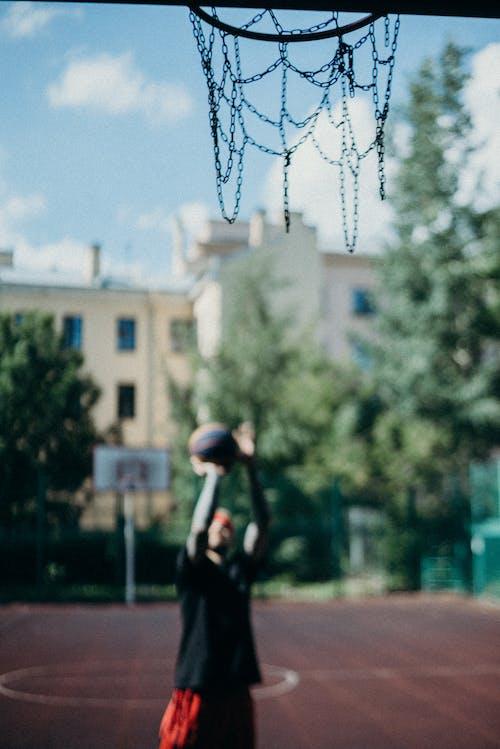 Low Angle Photography of a Basketball Hoop