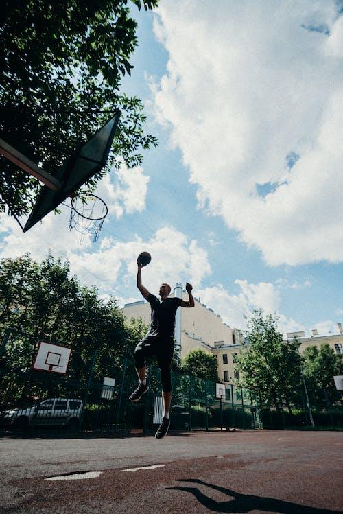 Man in Black T-shirt and Black Shorts Playing Basketball
