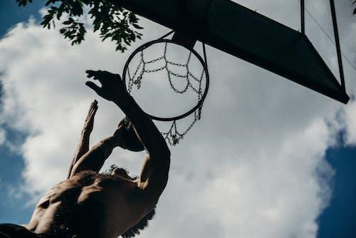 Low Angle Photography of Basketball Dunk