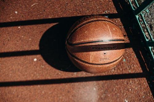 Brown Basketball on Brown Concrete Floor