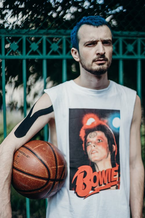 Man in White and Black Crew Neck T-shirt Holding Basketball