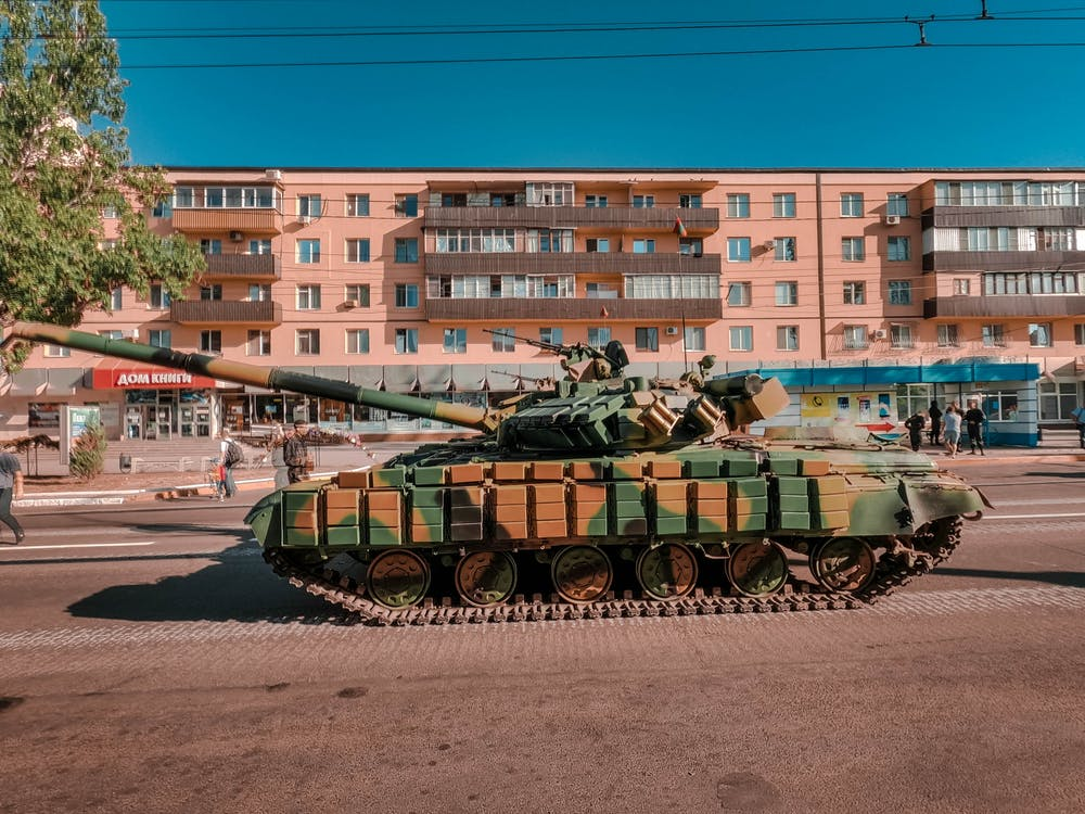 Green and Brown Battle Tank on Road