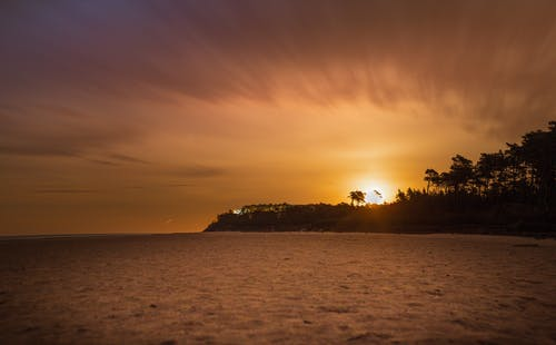 Amazing sunset sky over sea surrounded by tropical trees