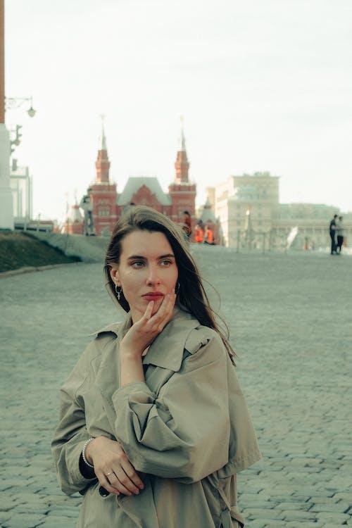 Woman in Gray Coat Near Body of Water