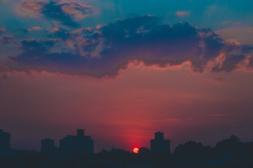 Bright sunset sky over modern city