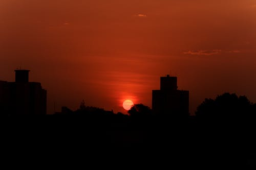Silhouette of city in bright sunset