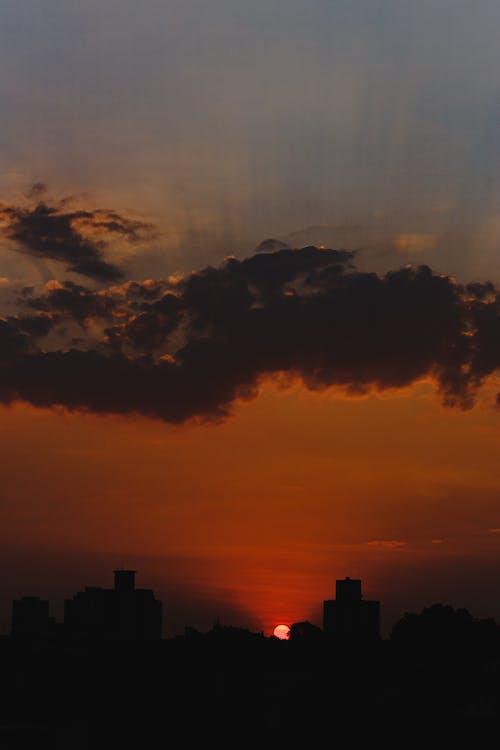 Sunset sky over city in dark