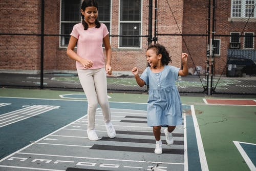 Children Running on the Concrete Floor