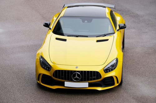 A Yellow Sports Car on the Asphalt