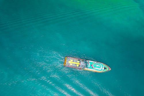 Powerful boat floating on azure seawater