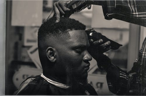 Serious black man visiting barber shop