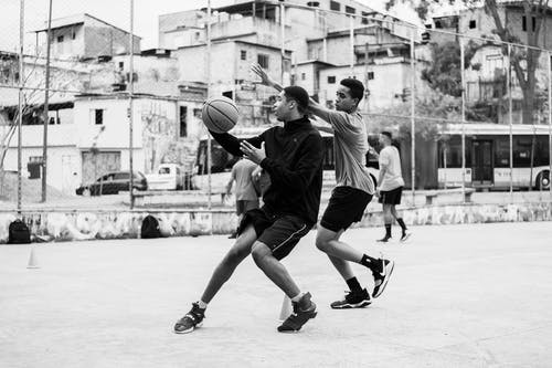 Grayscale Photo of 2 Men Playing Basketball