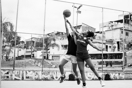 Man in Black T-shirt and White Shorts Playing Basketball