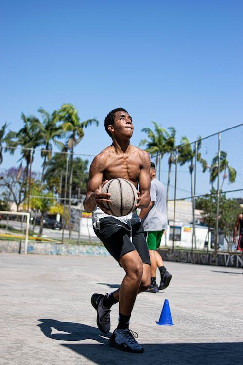 Man in Black Shorts Running on Road