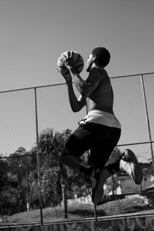 2 Men Playing Basketball in Grayscale Photography