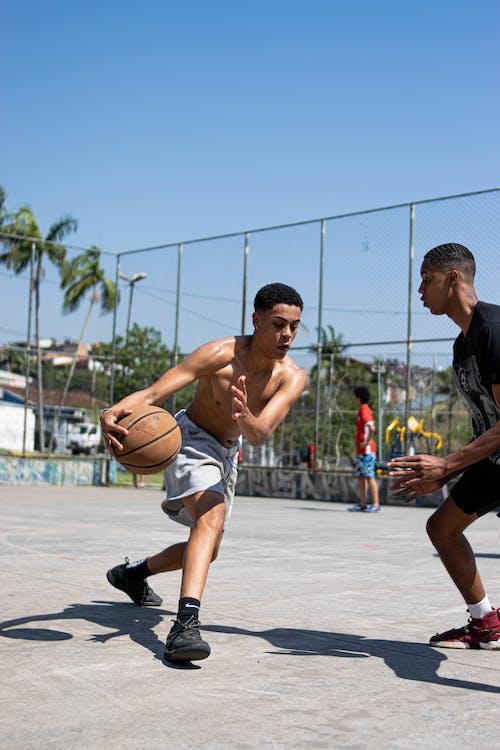 Man in Black Shorts Running on Basketball Court