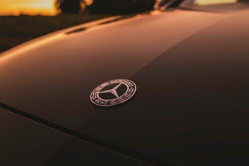 Black Mercedes Benz Car in Front of Black Car